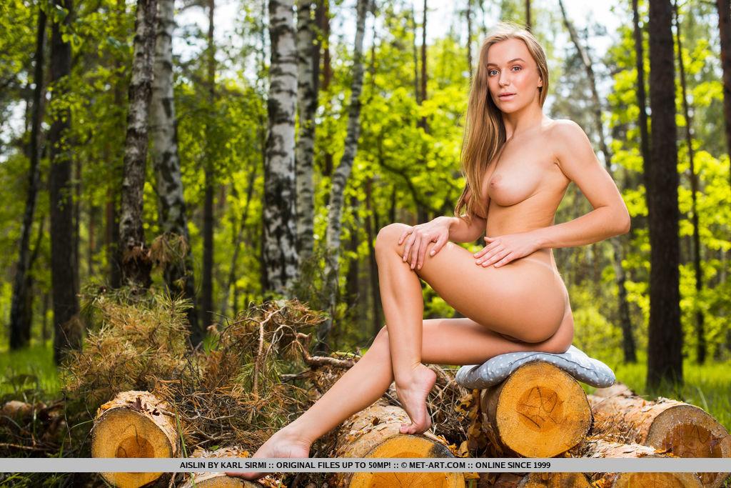 This woman has medium natural breasts and Blonde hair