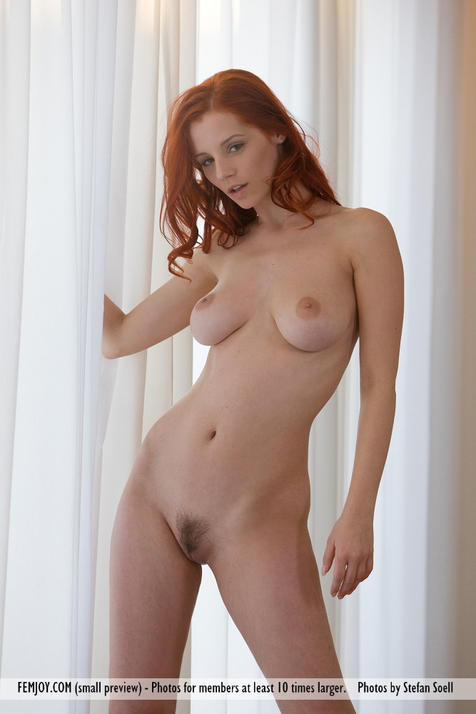 This young lady has amorous large boobs and Red hair, Green eye