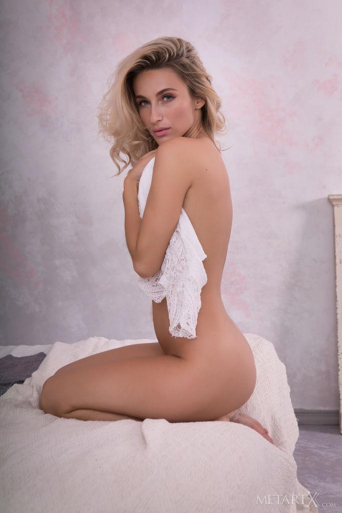 Cara Mell inviting medium breasts portrait