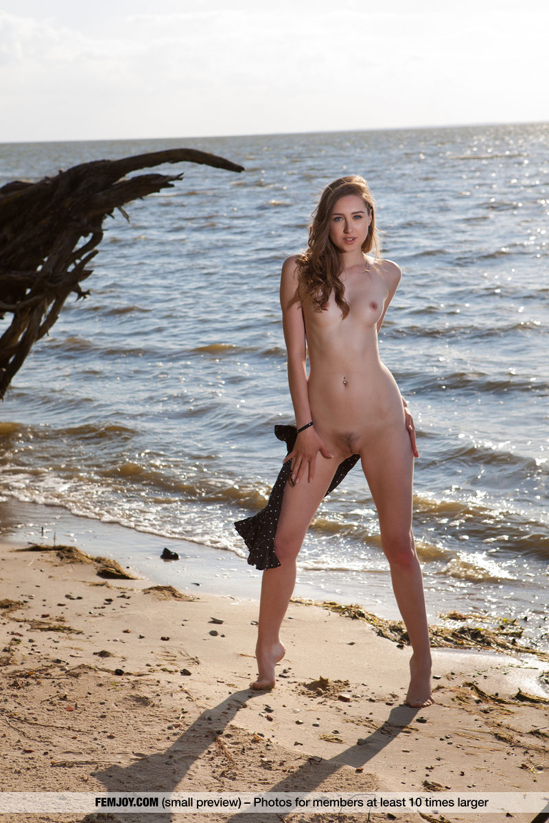 This young lady has sexual small naturalbreasts and Brown hair