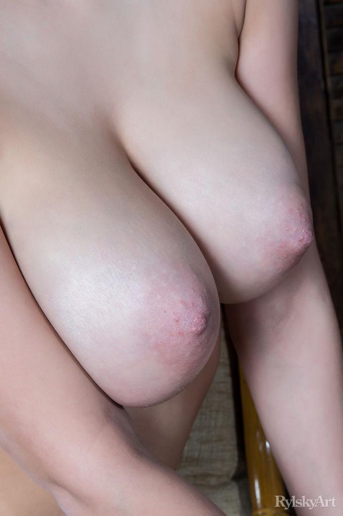 This woman has bawdy big tits and Black hair
