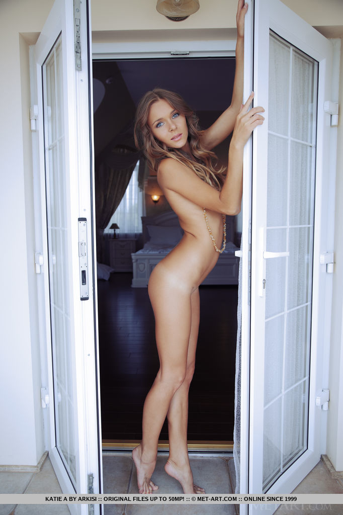 This woman has bare-skinned small naturaltits and Brown hair