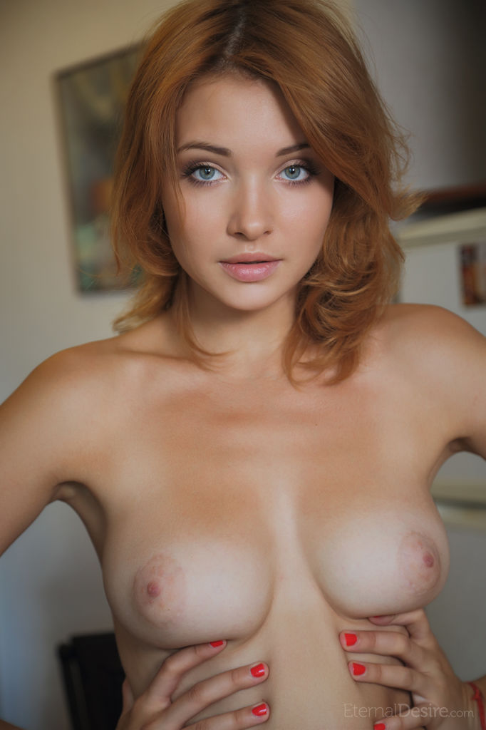 This woman has medium breasts and Red hair