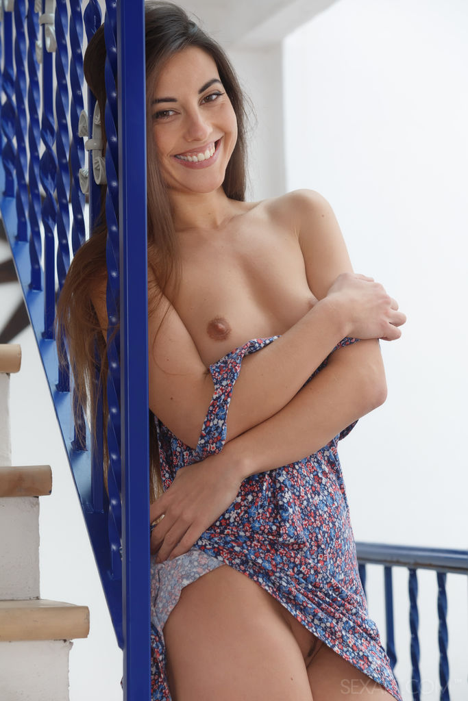 This young lady has disrobed small boobs shot