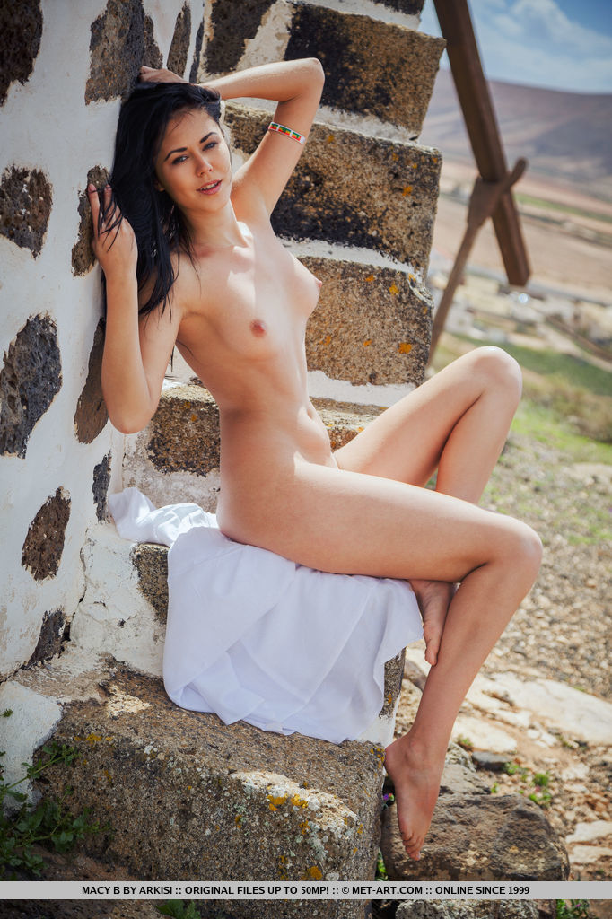 This young lady has unclothed small naturaltits and Black hair