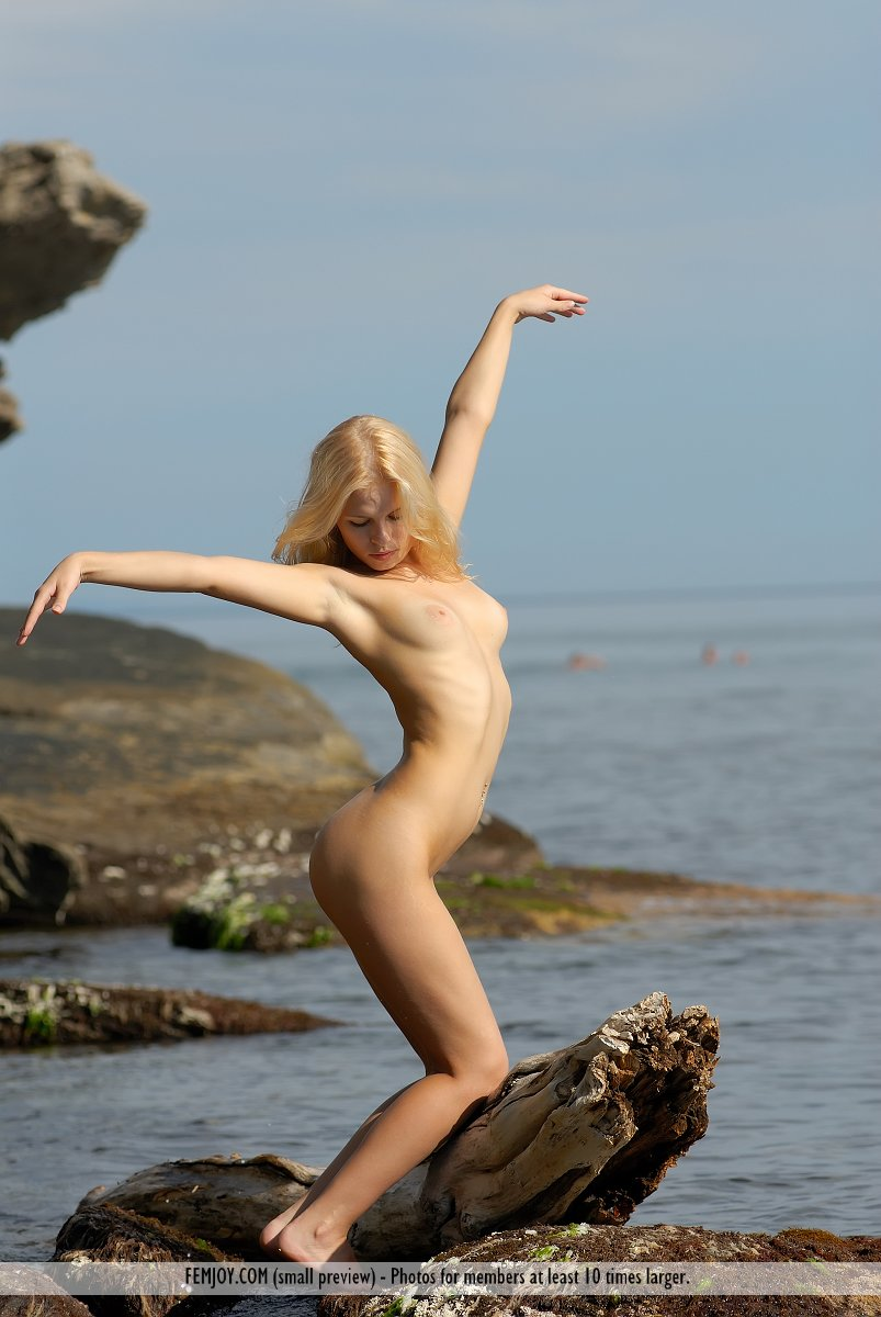 This young lady has undressed small breasts and Green eye