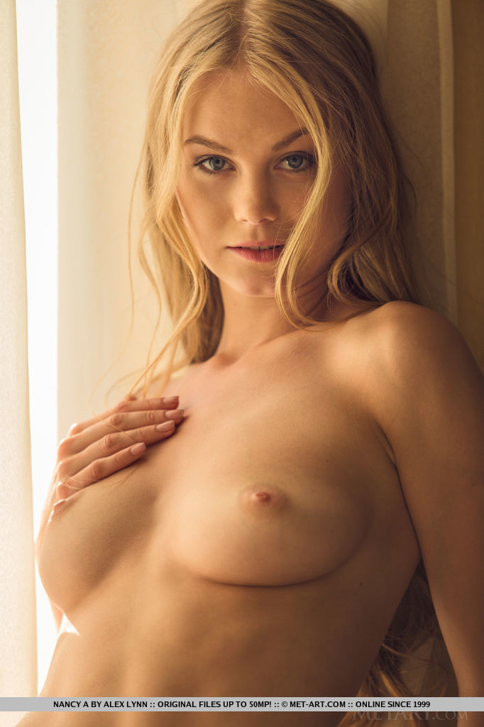 This young lady has undraped big boobs and Blonde hair