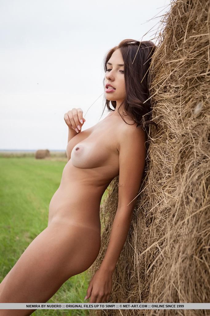 This woman has magnificent medium naturalboobs and Brown hair
