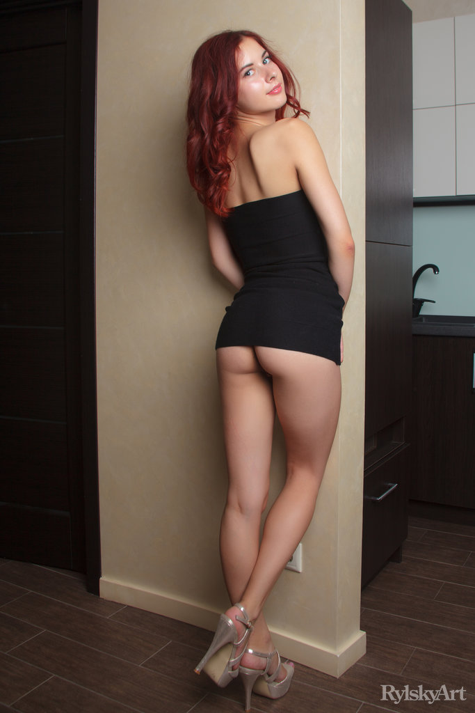 This young lady has undressed small boobs and Red hair, Blue eye