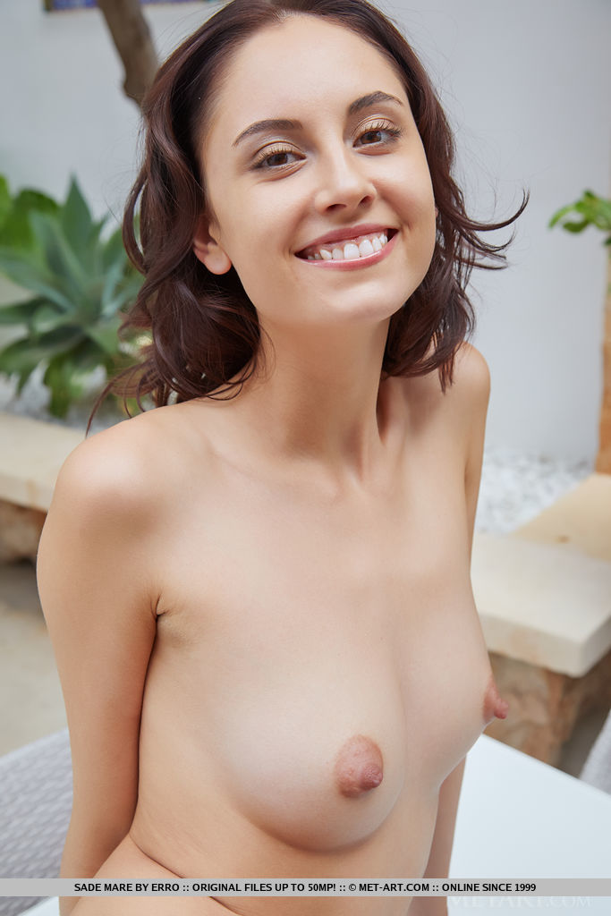 This girl has attractive small boobs and Brown hair