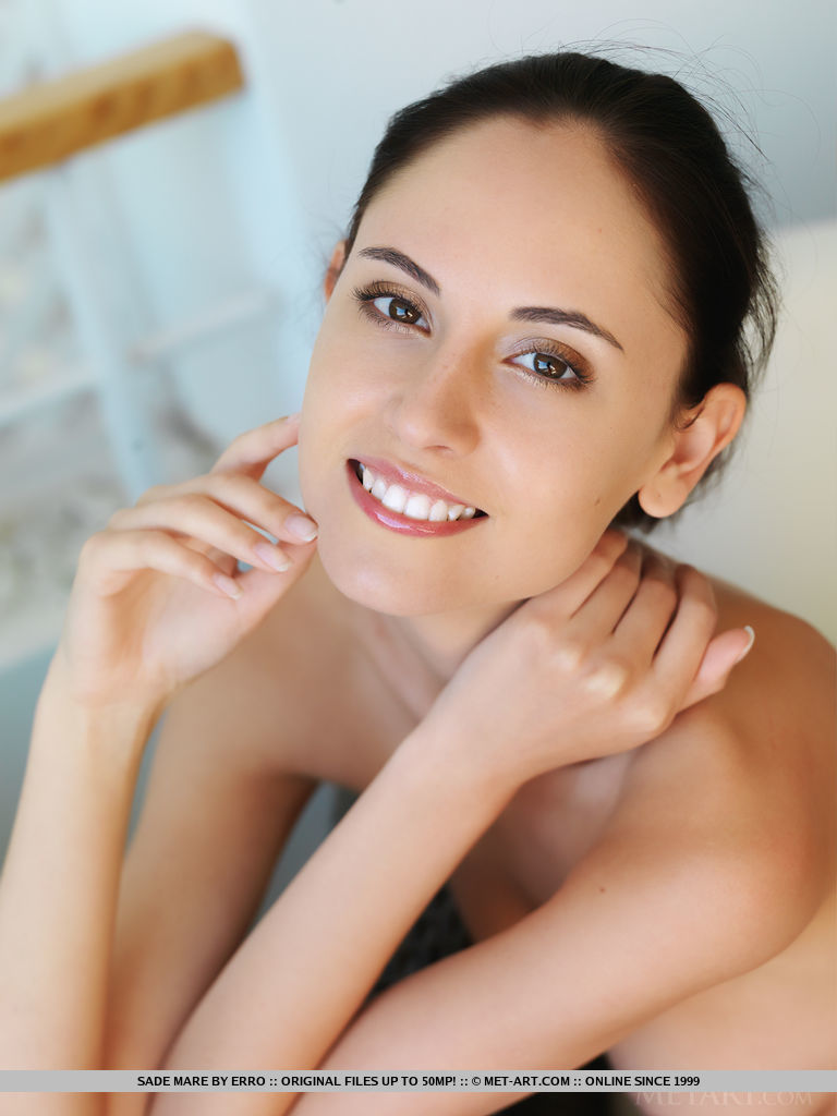 This young lady has wearing only a smile small naturalbreasts and Brown hair, Brown eye