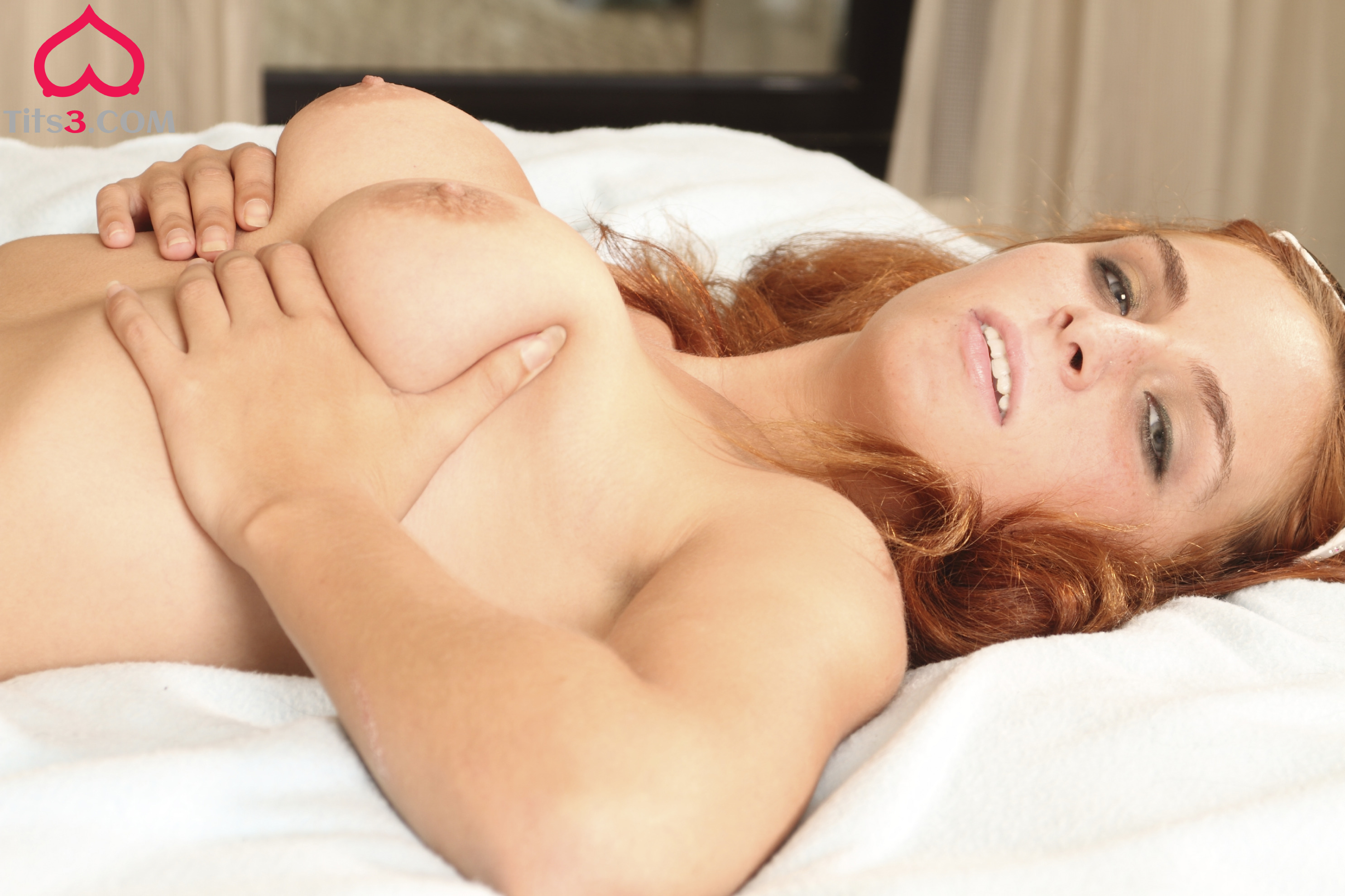 29 Ashley lies naked and squeezes her breasts