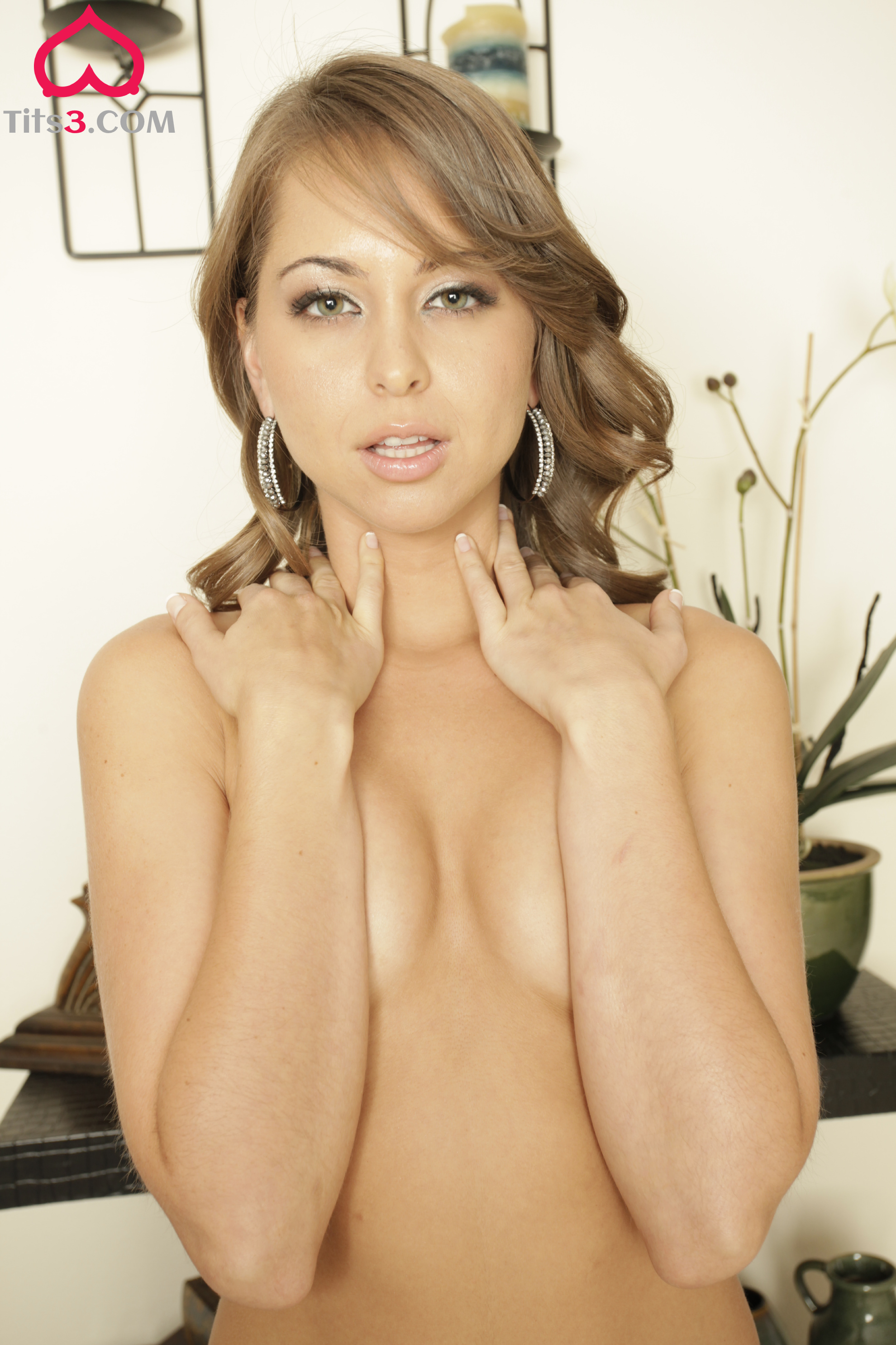 Riley Reid naked covers her breasts with her hands