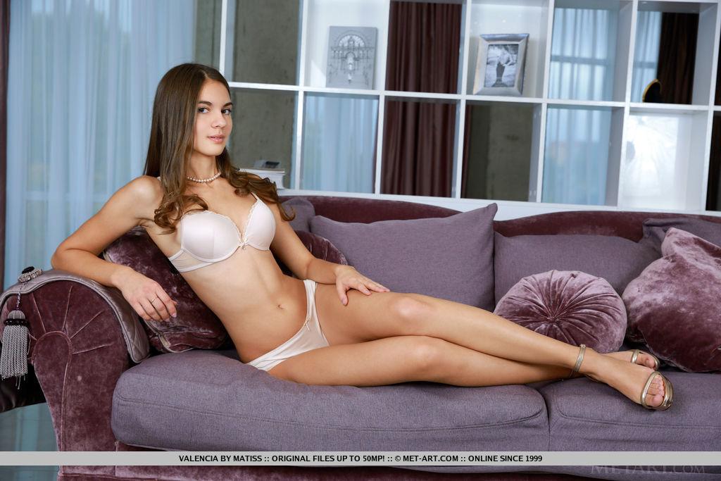 best brunette girl dressed in satin white lingerie