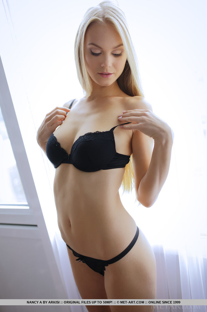 blonde girl with delicate black panties and bra
