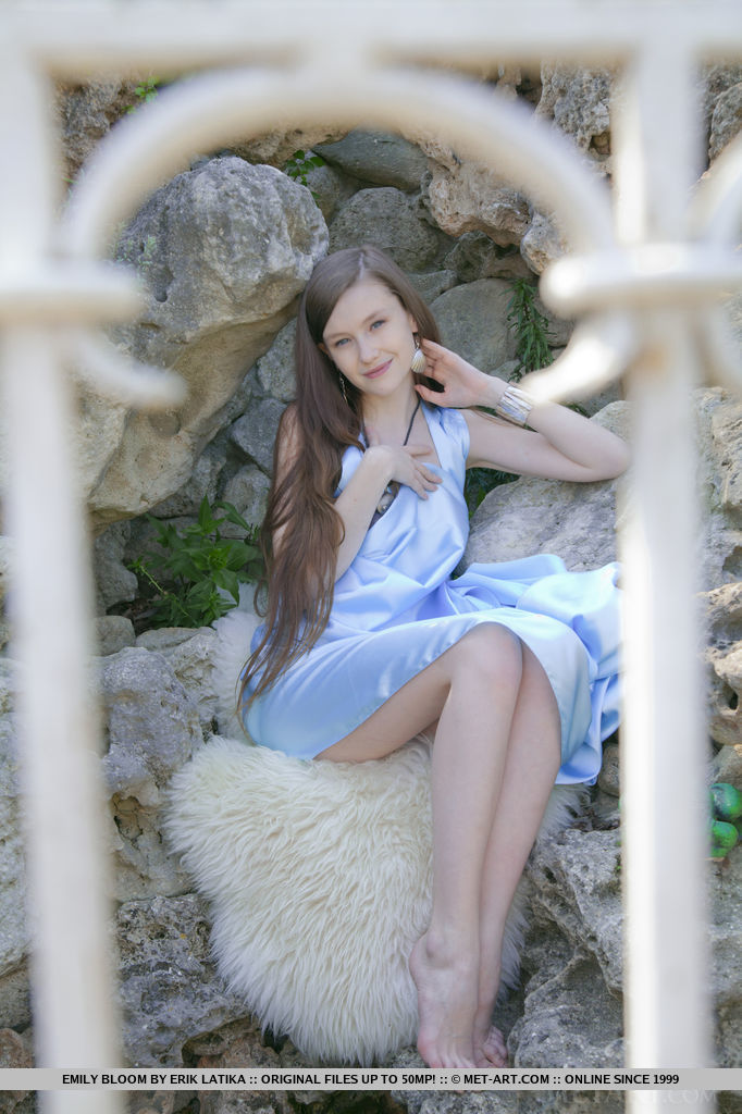emily bloom dressed in very sexy light blue sating gown that legs with thighs can be clearly seen