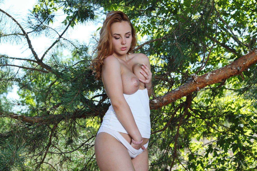 unearthly photo red head vos in one hand holds her tit and in the other hand is in panties
