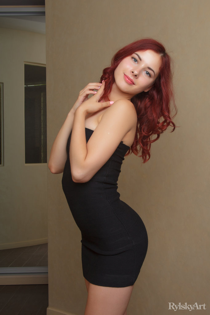 Pearl Ami is a beautiful red haired girl wearing a skimpy black tight dress