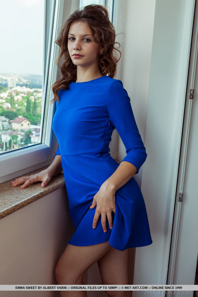 Emma Sweet is very tempting in a blue dress