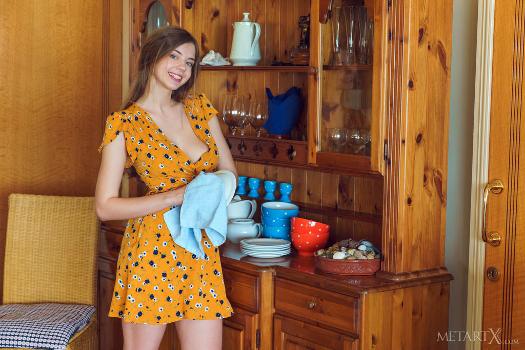Kay J in an orange dress is wiping the plates and her boob is almost falling out