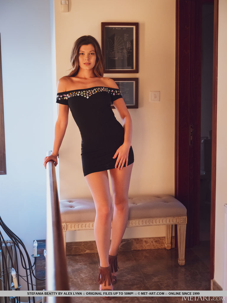 Stefania Beatty in a black dress