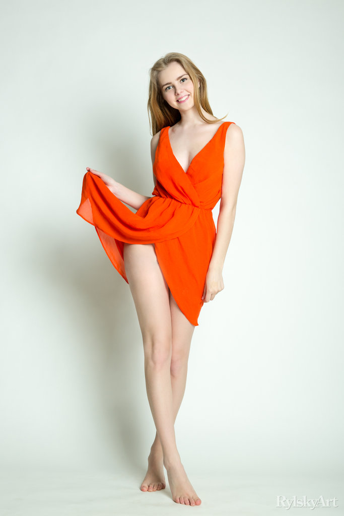 this time the marit is wearing an orange dress slightly revealing her long legs