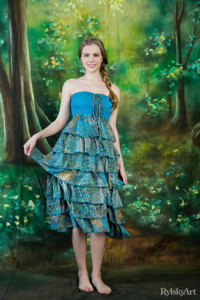 marit dressed in a richly decorated dress in shades of blue and green