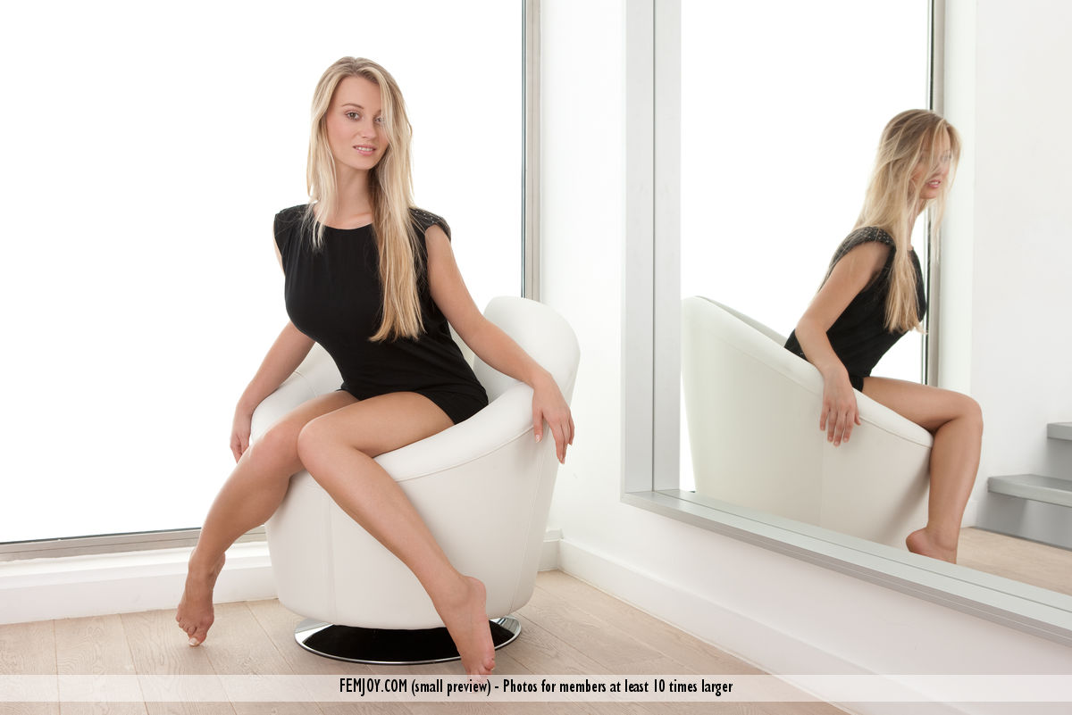 carisha long blonde girl with beautiful legs is wearing a black dress revealing the whole thighs