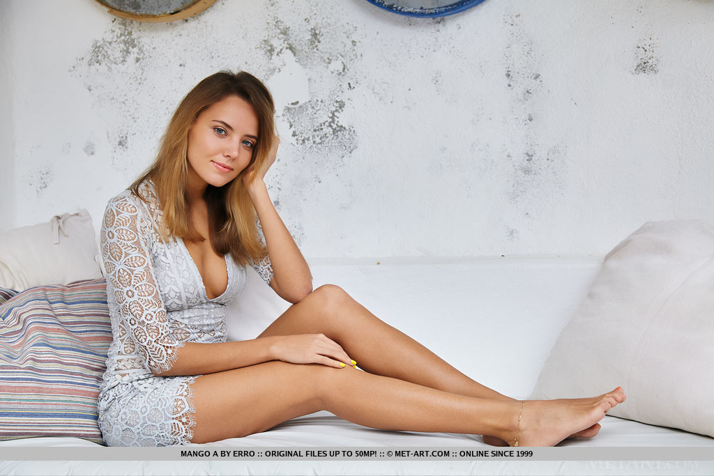 beautiful mango in a white lace dress with an exposed neckline