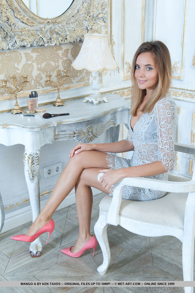 Mango in a white lace dress and pink high waisted shoes