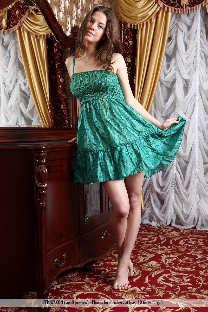 Danica hides her large breasts under her green satin dress