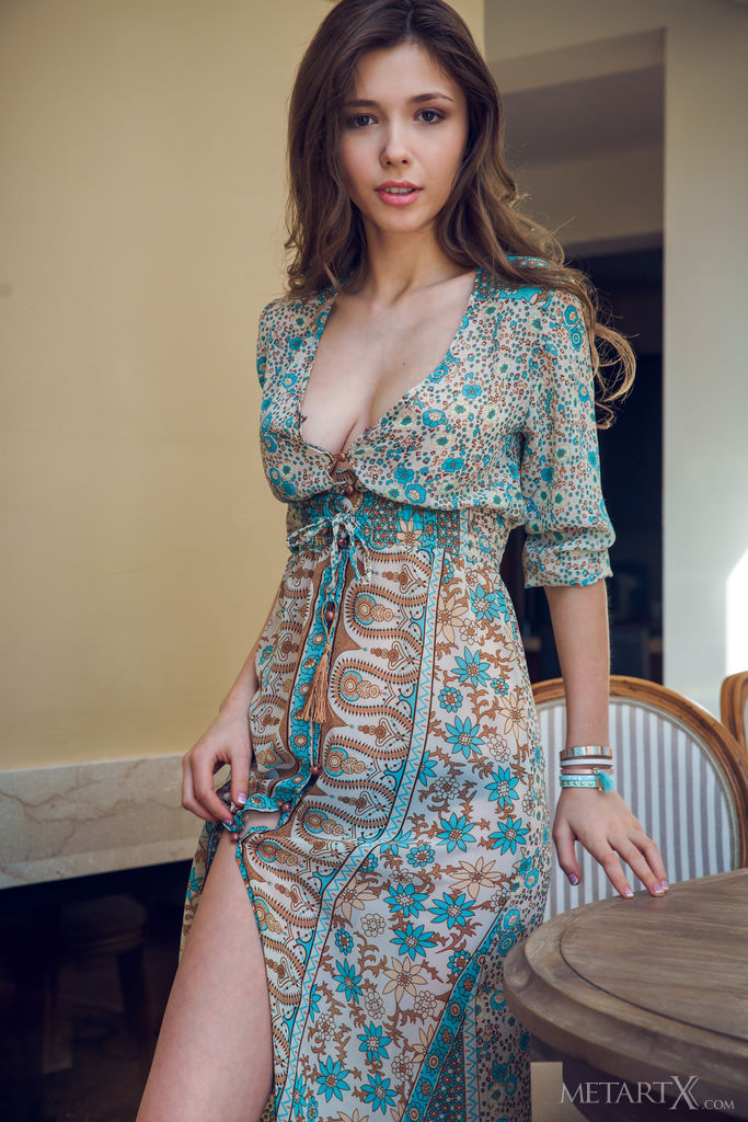 Mila Azul hides her big breasts under her dress