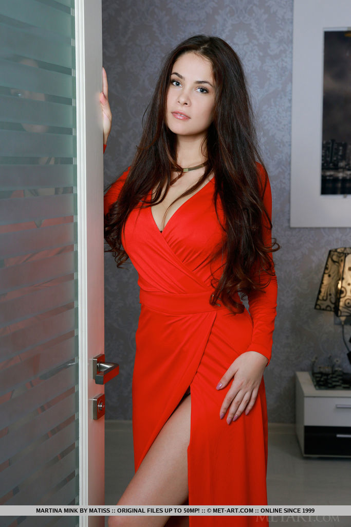 Martina Mink wearing a hot red dress with a large neckline makes her very hot