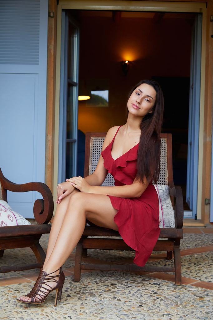 stunning long brunette in a burgundy dress