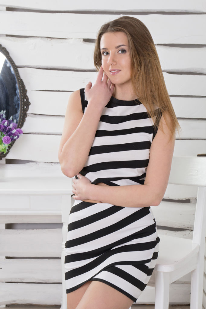 Beautiful blonde in a black and white striped dress