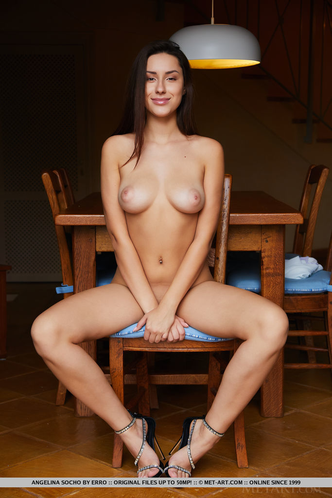 Angelina Socho is sitting in a chair all naked and her breasts are so symmetrical