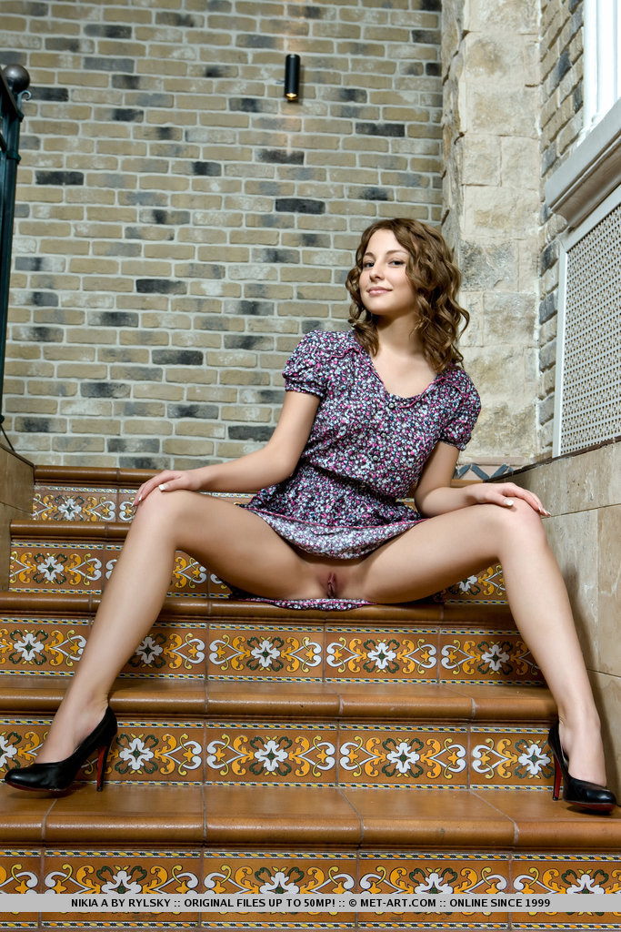Nikia A sits astride the stairs so that you can stick your fingers into her warm pussy