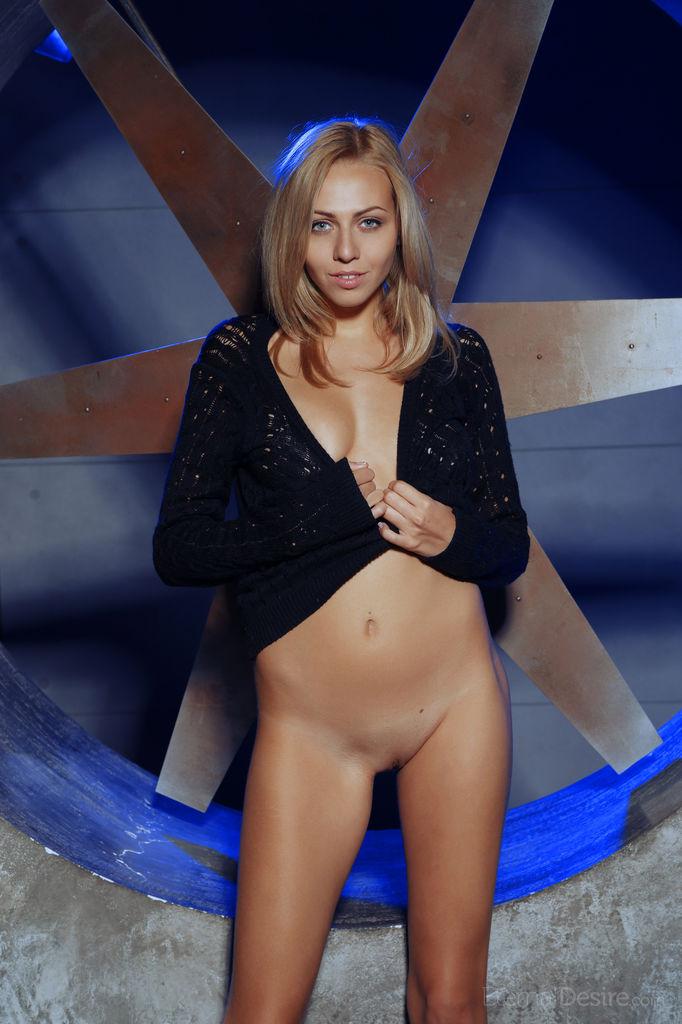 Lija hides her tits under a black sweater