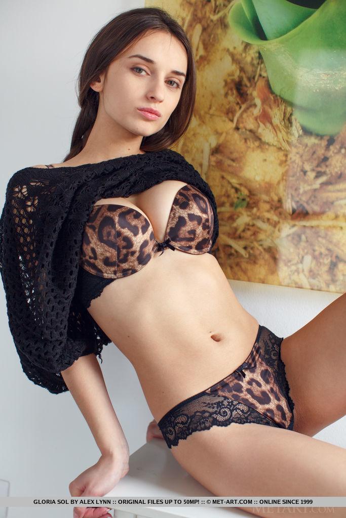 Gloria Sol wears leopard print underwear under a black sweater