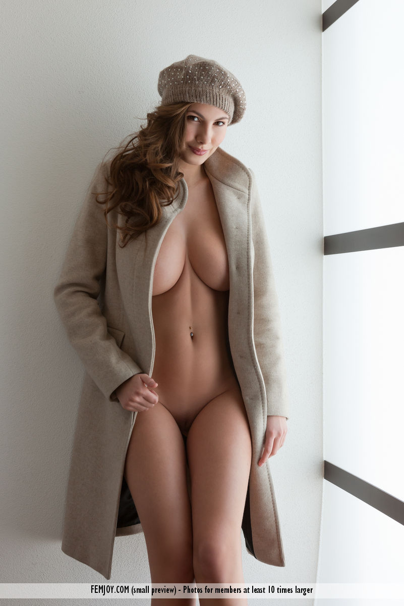 Connie Carter is a porn star who hides her ideal body under a gray coat